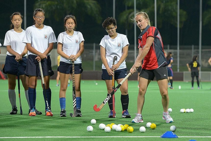 Australia forward Emily Smith, 23, guiding the girls from the TPG Academy Development Squad in a clinic held by the world No. 3 Hockeyroos ahead of the TPG International Tri-Series hockey tournament next week. The top-ranked Dutch and world No. 9 Ger