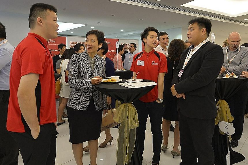 Minister for Culture, Community and Youth Grace Fu (second from left) with Team Singapore athletes (in red polo shirt) Peter Kam and Shayna Ng at yesterday's launch of the spexEntrepreneurship programme.