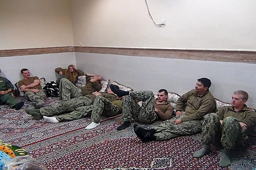 A statement by Iran's Revolutionary Guards said the sailors were released after it was found they did not enter Iranian waters intentionally. The incident came as Iran prepares to implement a nuclear deal with world powers, aimed at ending its long i