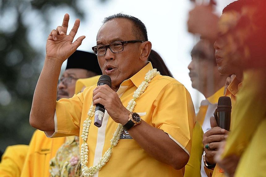 Golkar chairman Aburizal Bakrie on the campaign trail during the Indonesian presidential election in 2014. On Monday, he pledged to support the government after a meeting with Mr Joko.