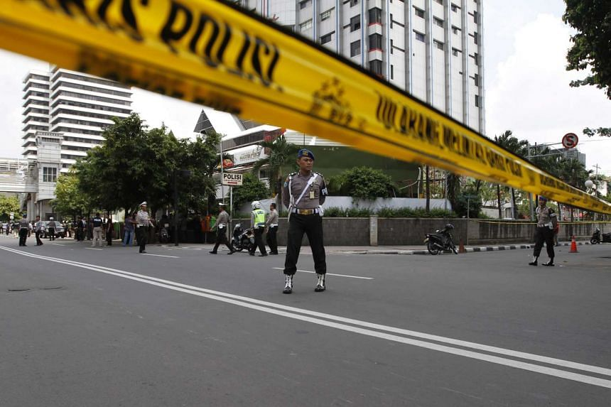 A general view shows a police cordon sealing off the scene of a bomb blast in Jakarta.