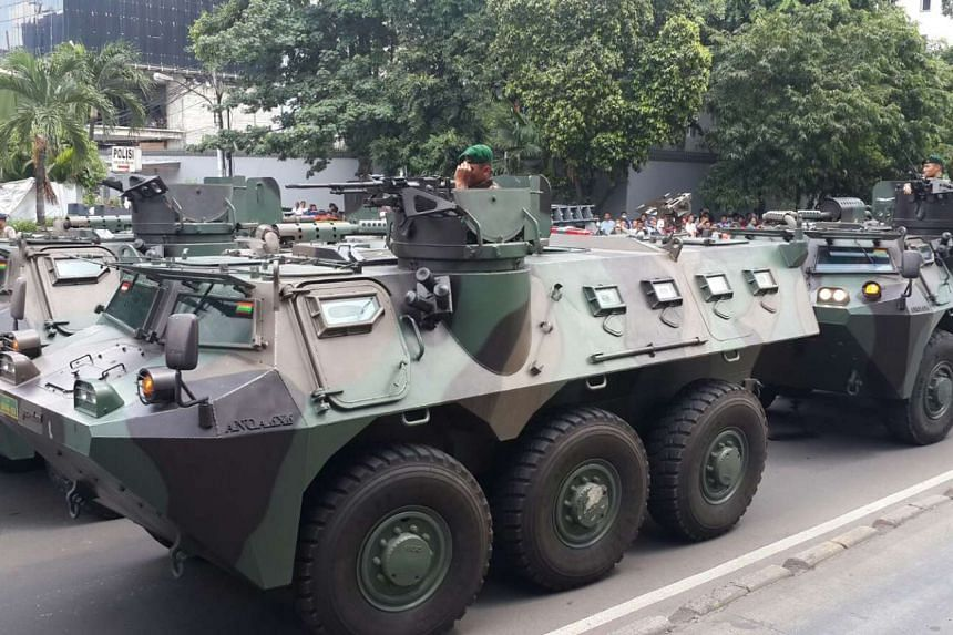 Armoured personnel carriers deployed in Jakarta where a hunt was underway for gunmen after several blasts on Jan 14, 2016.