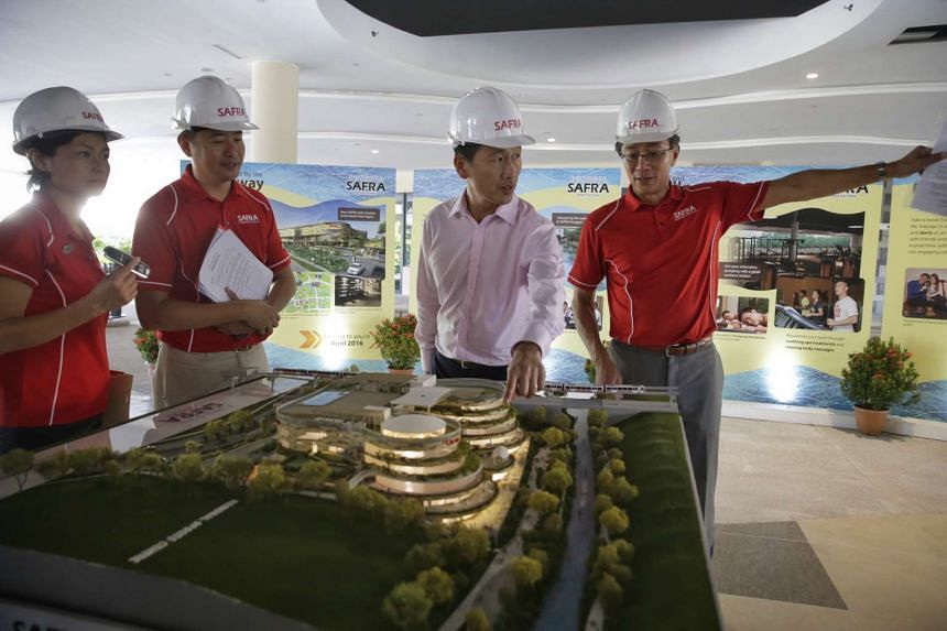 Senior Minister of State for Defence Ong Ye Kung (second from right) touring the new Safra Punggol.