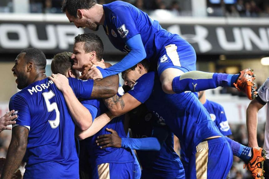 Robert Huth (third from left) celebrates with teammates after scoring the only goal of the English Premier League football match between Tottenham Hotspur and Leicester City.