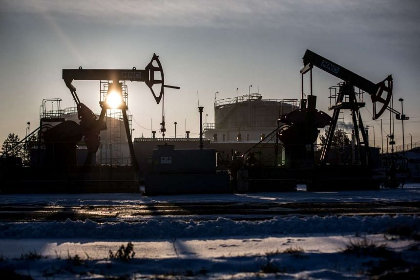 Oil and gas firms are being forced into survival mode as oil prices have fallen to levels last seen in 2004, Wood Mackenzie said.