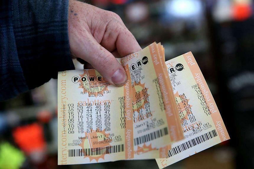 A customer holds a handful of Powerball tickets at Kavanagh Liquors on Jan 13, 2016 in San Lorenzo, California.