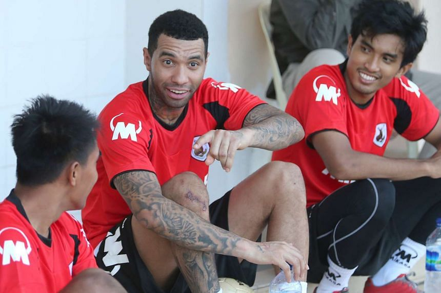 Jermaine Pennant (centre) sharing a moment with Yasir Hanapi (right) and Firdaus Kasman at a training session with Tampines Rovers at the Jurong West Stadium on Jan 8, 2016.