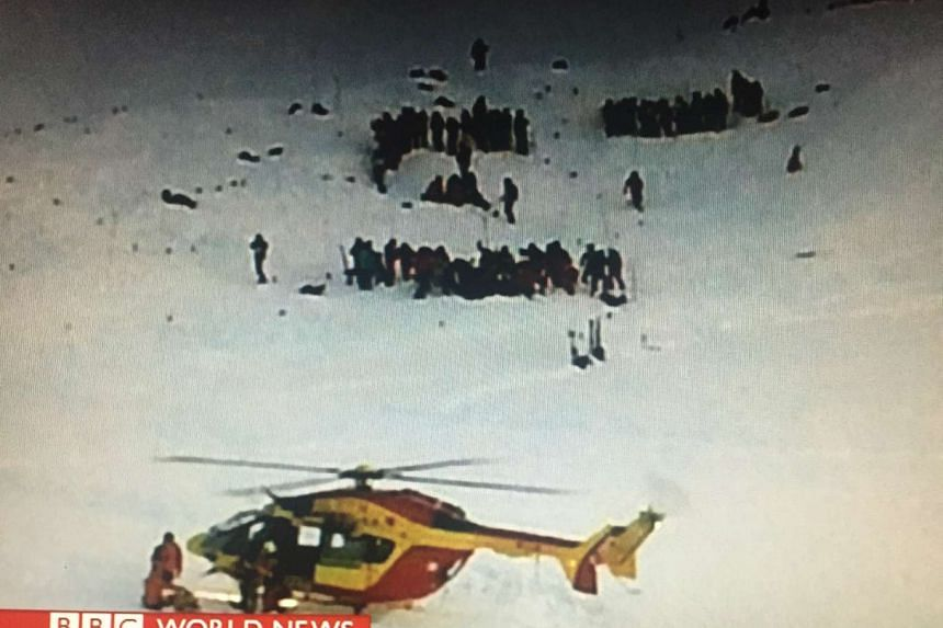 A rescue helicopter lands at the scene of the avalanche at the Deux-Alpes resort in eastern France.