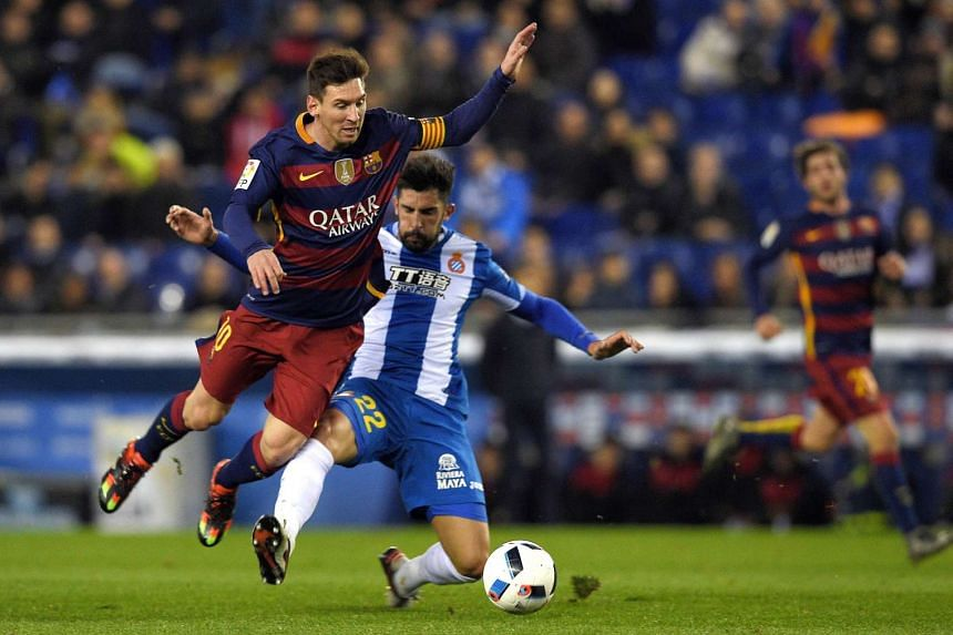 Barcelona's Argentinian forward Lionel Messi (left) vies with Espanyol's defender Alvaro Gonzalez (right) on Wednesday.