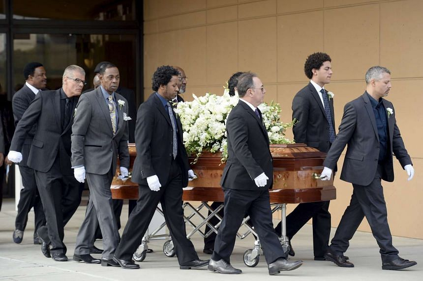Pallbearers with Natalie Cole's coffin after Monday's funeral service (above), which was attended by music industry veterans including Smokey Robinson, David Foster, Lionel Richie and Stevie Wonder.