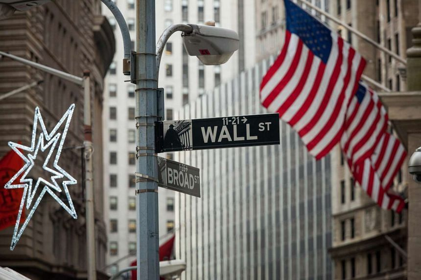 A Wall Street sign outside the New York Stock Exchange (NYSE) in New York, US, on Jan 8, 2016.