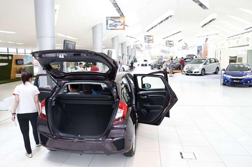 Potential buyers looking at cars at the Honda showroom at Alexandra Road.