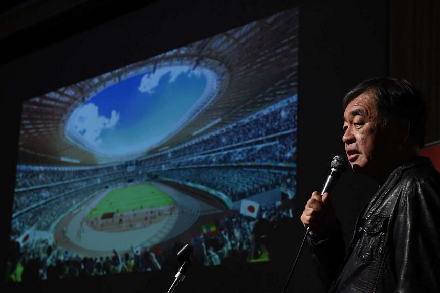 Architect Kengo Kuma explains his design of the stadium during a press conference in Tokyo on Dec 22, 2015.