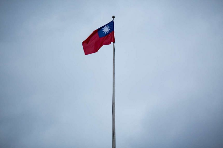 The Taiwan flag flies on a pole in the Chiang Kai-shek Memorial Hall square in Taipei, Taiwan.