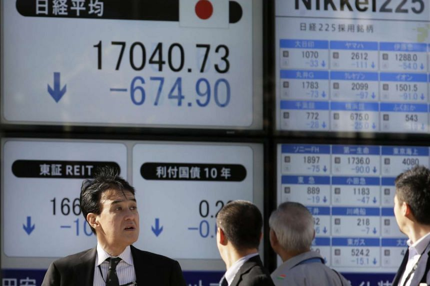 A screen displaying stock information in Tokyo on Jan 14.