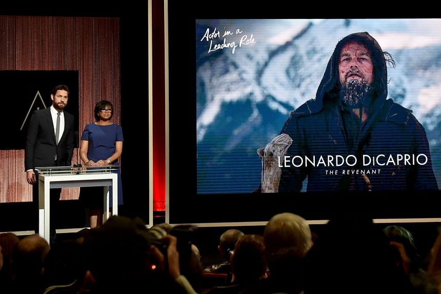 John Krasinski and Cheryl Boone Isaacs announce Leonardo DiCaprio as nominee for Best Actor in a Leading Role during the 88th Oscars Nominations Announcement.