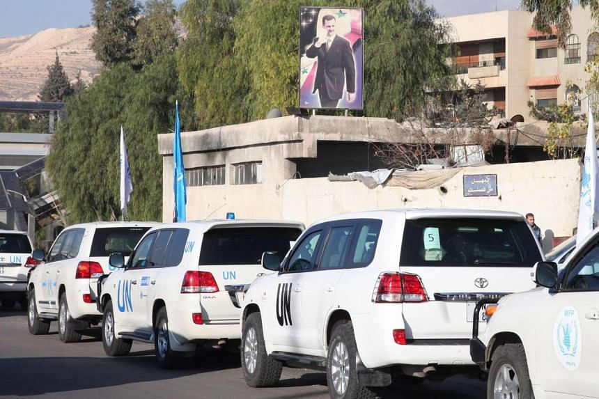UN vehicles loaded with food, medicine, blankets and other materials heading to the besieged town of Madaya.