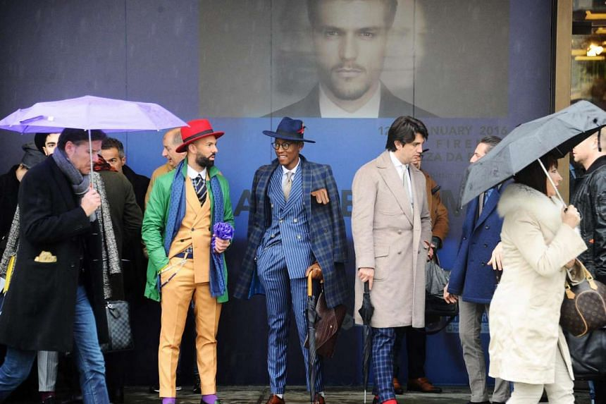 Visitors at the 89th Pitti Uomo menswear fashion event in Florence, Italy, on Jan 14.