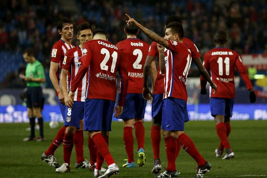 Fifa yesterday banned Atletico Madrid from buying footballers for one year over their dealings in under-age players.