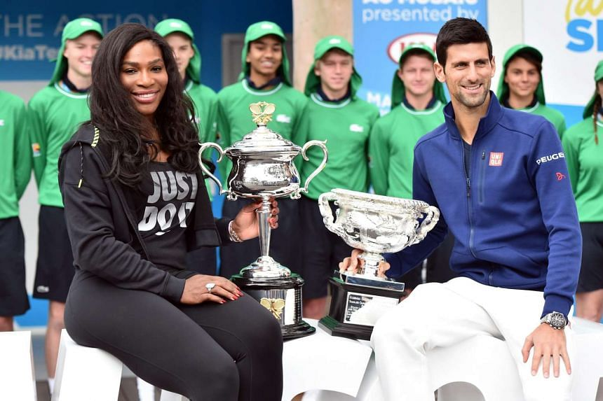 Serena Williams (left) and Novak Djokovic (right) posing with their trophies at the Australian Open tennis tournament draw on Jan 15, 2016.