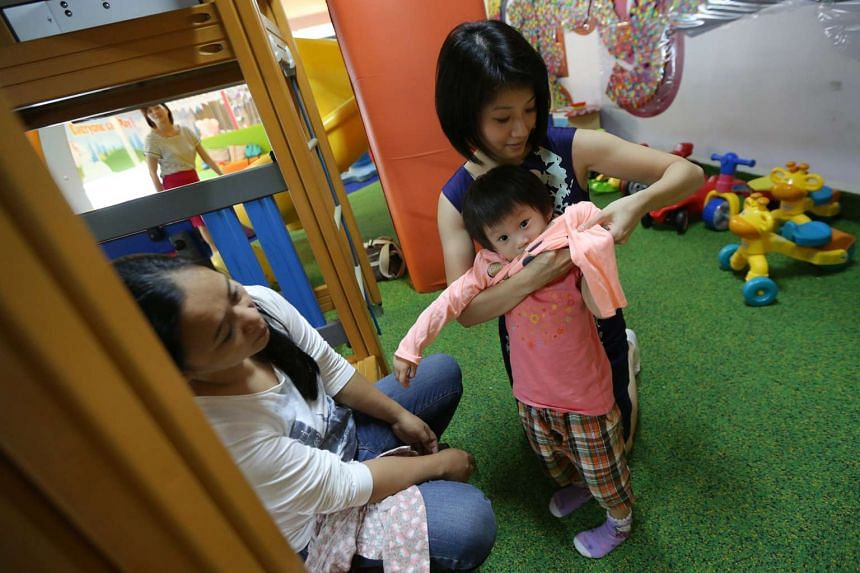 Ms Sun Xueling with her two-year-old daughter.