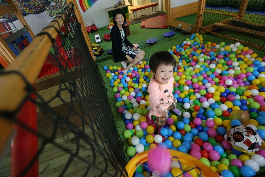 Ms Sun Xueling dropping by an indoor playground in Marine Parade to visit her two-year-old daughter.