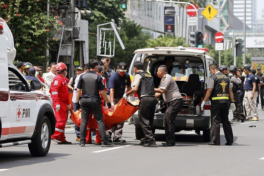 A medical team carrying the body of a victim into an ambulance at the scene of a bomb blast in Jakarta on Jan 14.