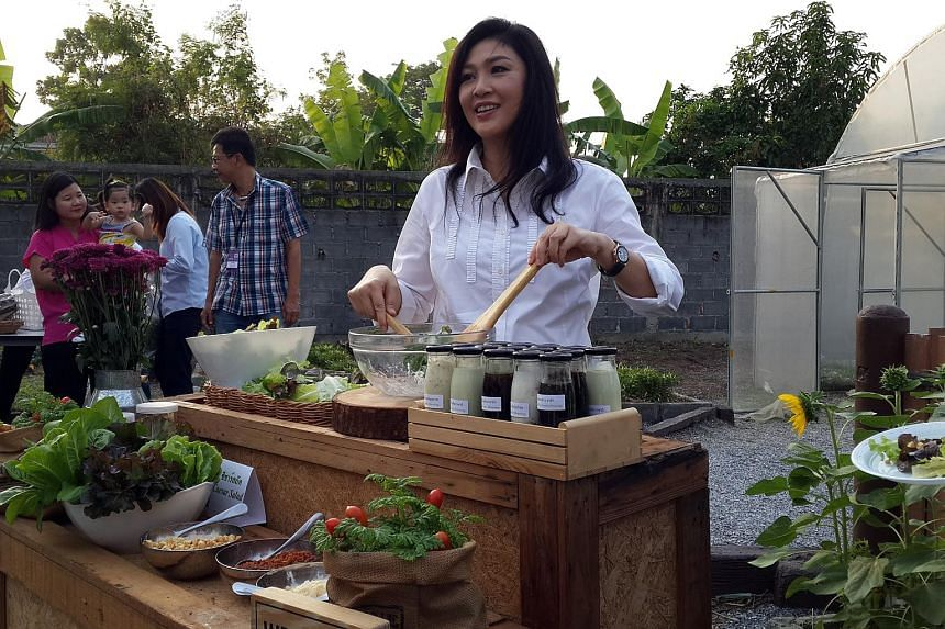 Ousted Thai prime minister Yingluck Shinawatra making salad for invited reporters at her Bangkok residence on Jan 8.