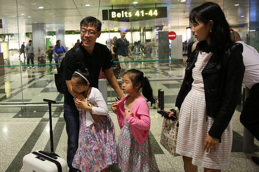 A man is greeted by his family at Changi Airport after his return from Jakarta on Jan 14.