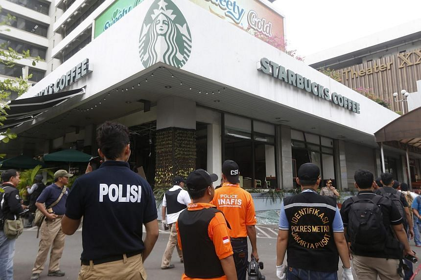 Forensic officers working at the scene of a bomb blast in front of a shopping mall in Jakarta, Indonesia, on Jan 14, 2016.