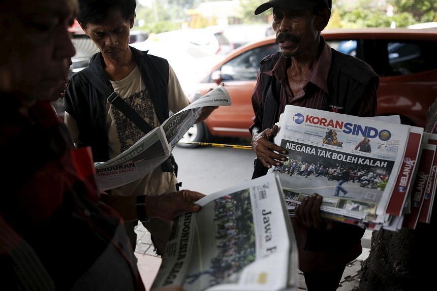 A newspaper vendor at the site of yesterday's gun and bomb attack in Jakarta on Jan 15.