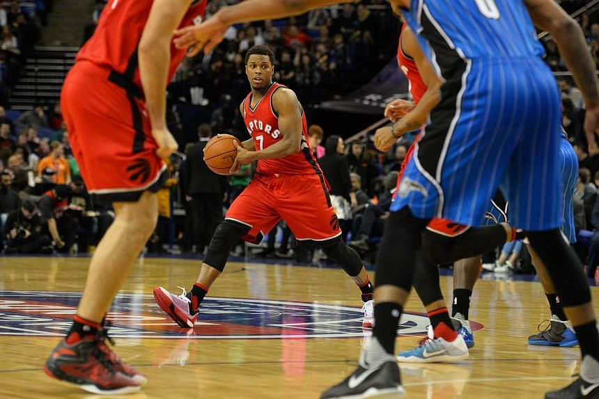 Kyle Lowry (centre) passing the ball during the match between Orlando Magic and Toronto Raptors on Jan 14, 2016.