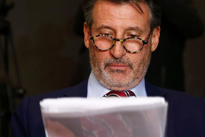 IAAF president Sebastian Coe checking documents ahead of a news conference by former Wada president, Dick Pound, who heads the commission into corruption and doping in athletics