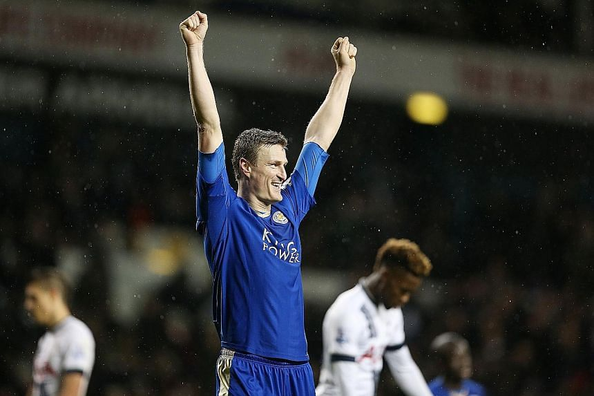 Leicester City's Robert Huth celebrating after their match against Tottenham, as his late goal proved to be the winner. His strike ended a 374-minute goal drought for the Foxes in the Premier League.