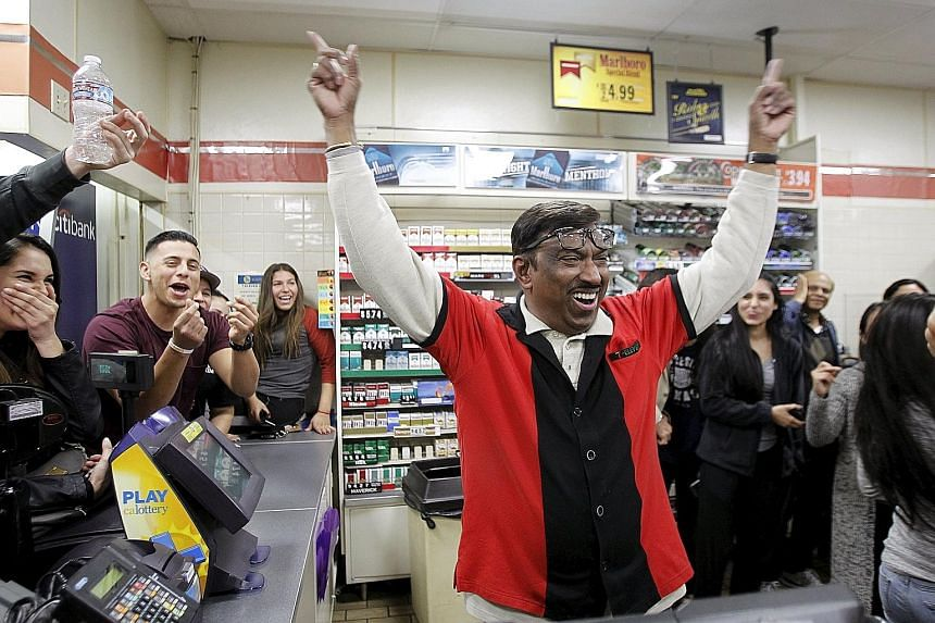 Mr M. Faroqui, a 7-Eleven employee in Chino Hills, California, celebrating on Wednesday after finding out that the store had sold one of the winning Powerball tickets. The store will receive a US$1 million bonus, lottery officials said. Wednesday's j