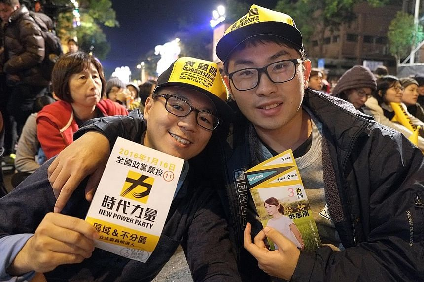 "Students Ou Ming (left), 22, and Lin Chia-hsien, 21, at a rally for the New Power Party in Taiwan. ""We need a party that tilts left, one that cares about the people,"" says Mr Lin."