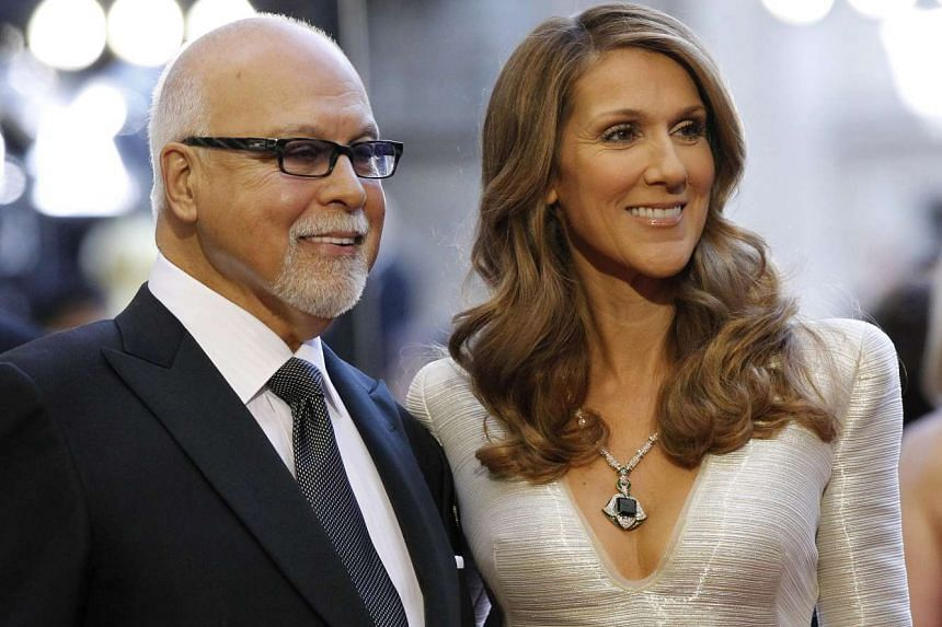 Dion and Angelil arrive at the Oscars in a 2011 file photo.