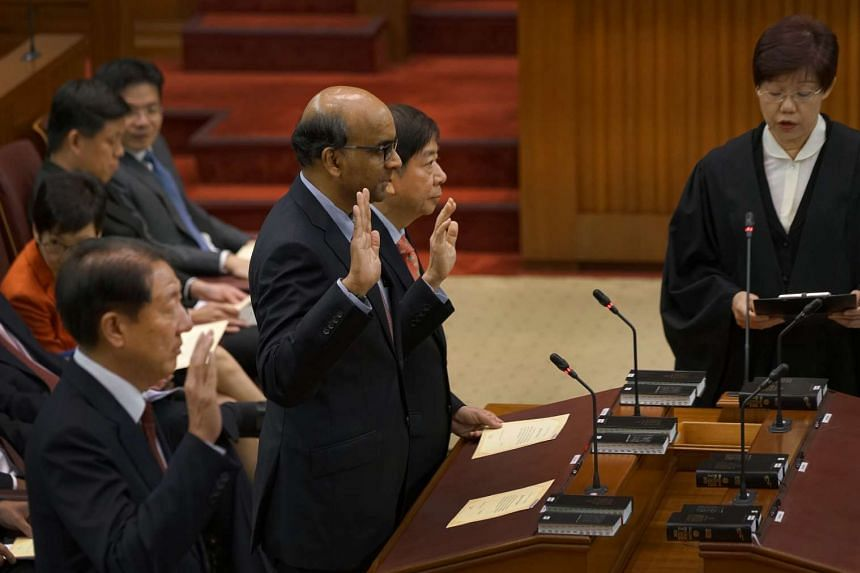 (From bottom left) Deputy Prime Minister Teo Chee Hean, Deputy Prime Minister Tharman Shanmugaratnam and Transport Minister Khaw Boon Wan being sworn into Parliament on Jan 15, 2016.