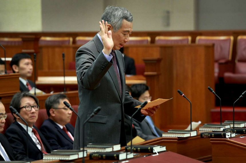 Prime Minister Lee Hsien Loong, who is MP for Ang Mo Kio GRC, being sworn into Parliament on Jan 15, 2016.