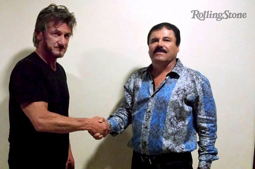 """Penn (left) shakes hands with Mexican drug lord Joaquin """"Chapo"""" Guzman in Mexico."""