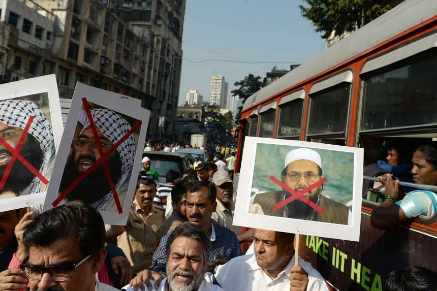 Activists in Mumbai carrying photographs of the chief of Jaish-e-Mohammad, Maulana Masood Azhar (far left), and the chief of Pakistan's outlawed Islamic hardline Jamaat ud Dawa, Hafiz Mohammad Saeed, during a protest on Jan 4 against the attack on In