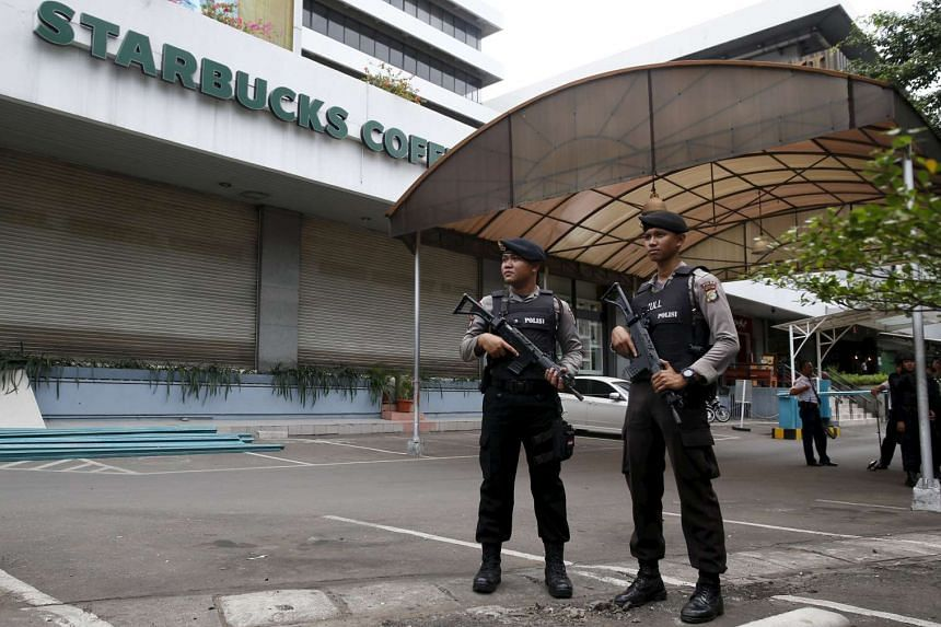 Indonesian police stand guard at the site of this week's militant attack in central Jakarta, Indonesia.
