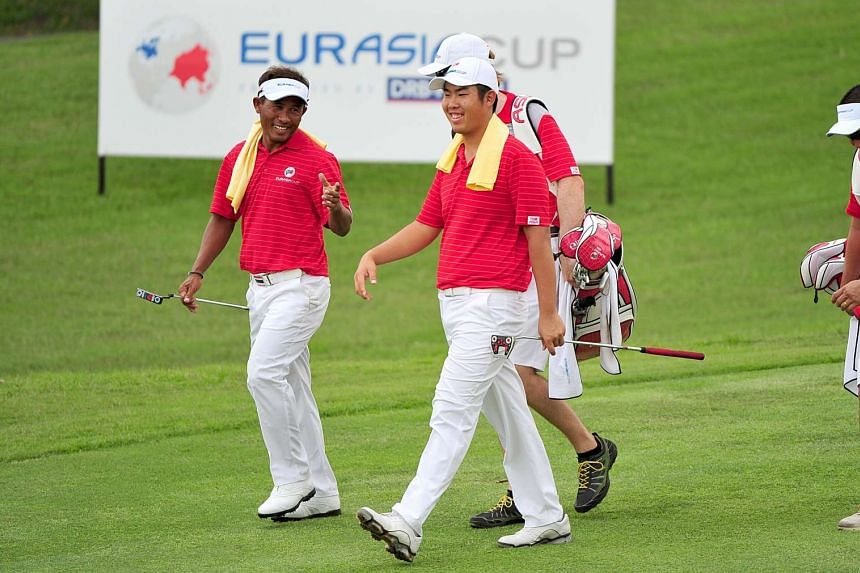 Thongchai Jaidee (left) and Byeonghun An of team Asia sharing a laugh during the first day's Fourball matches during the EurAsia Cup golf tournament.