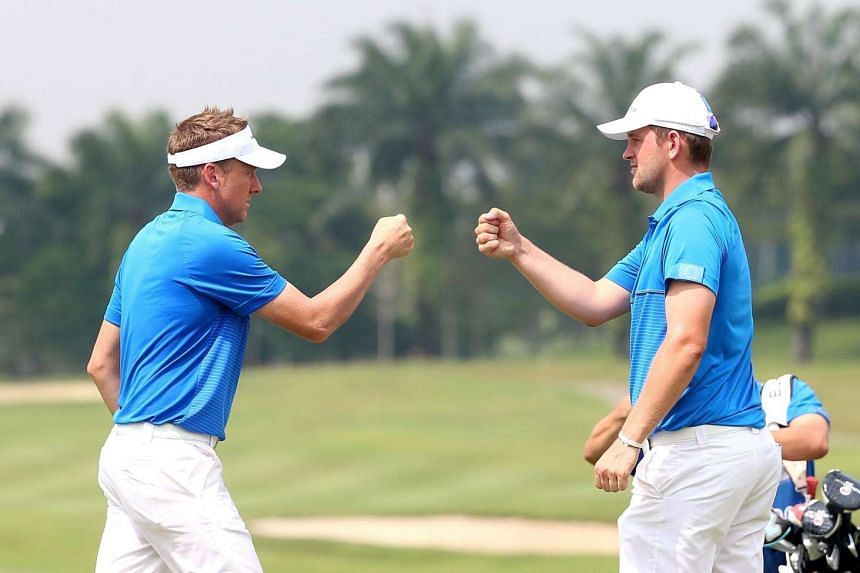 Britain's Ian Poulter (left) and Austria's Bernd Wiesberger celebrating a point at the EurAsia Cup in Shah Alam on Jan 15.