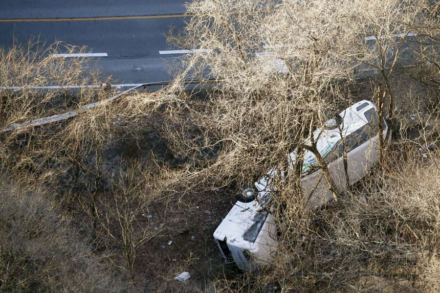 The tour bus that veered off a road is seen after it crashed in Karuizawa, Nagano prefecture, Japan, on Jan 15, 2016.