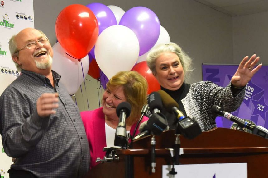 John and Lisa Robinson and Tennessee Lottery President and CEO Rebecca Hargrove (right) attending a news conference at the headquarters of the Tennessee Lottery.