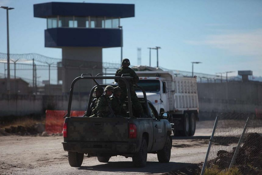 Soldiers patrol outside the Altiplano prison where Mexican drug lord Joaquin 'El Chapo' Guzman remains imprisoned.