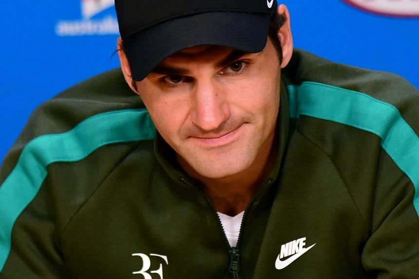 Roger Federer speaks with members of the media during a player press conference ahead of the Australian Open.