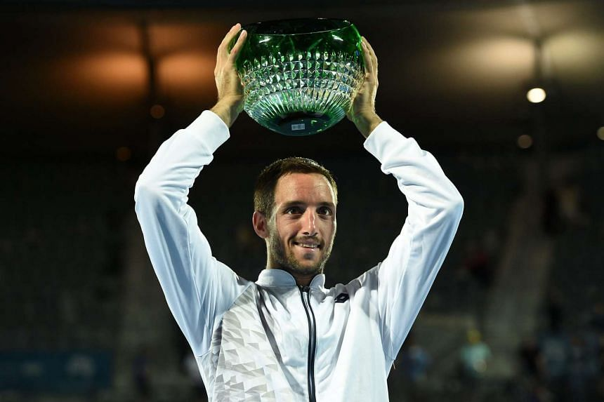 Viktor Troicki with his trophy after winning the men's final match against Grigor Dimitrov on Jan 16, 2016.