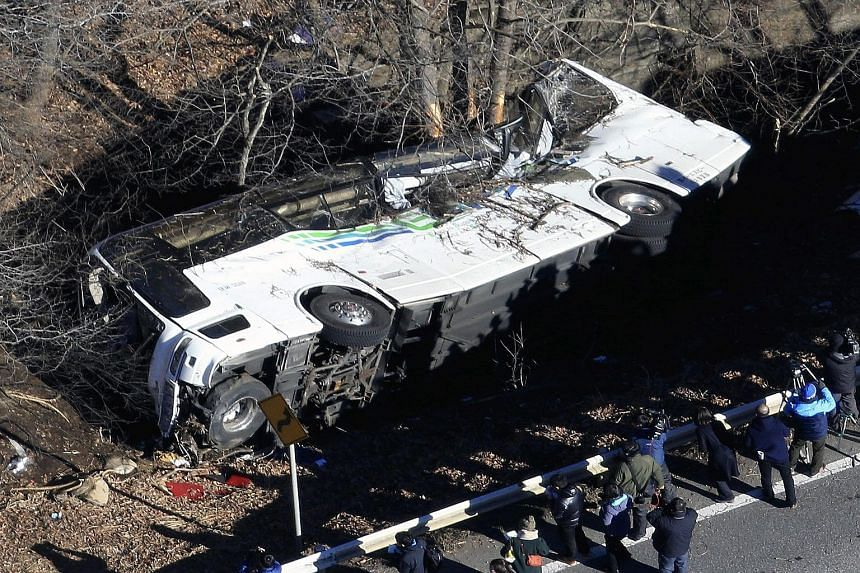 The bus carrying 41 people hit a guard rail, flipped over and fell 3m into a ditch in Nagano prefecture yesterday.